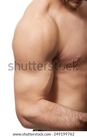 Handsome muscular man showing his biceps. - stock photo