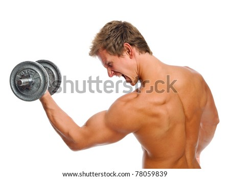 Handsome muscular man straining while doing his bicep exercise - stock photo