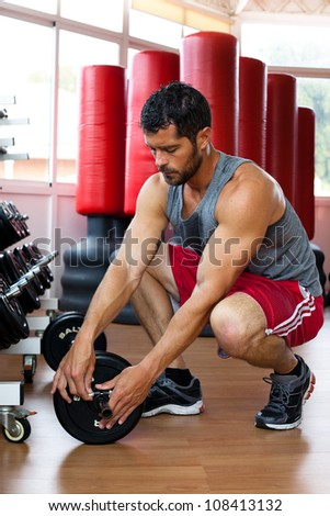 Handsome muscular man working out. - stock photo