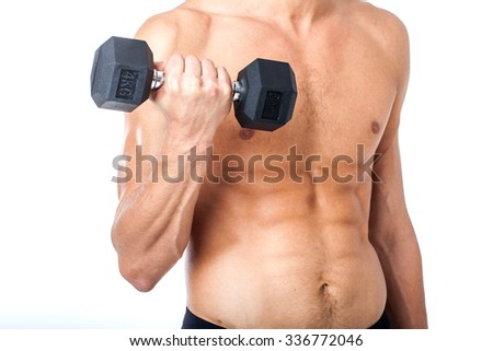 Handsome muscular man working out with dumbbells on white background. Strong bodybuilder with six pack, perfect abs, shoulders, biceps, triceps and chest - stock photo