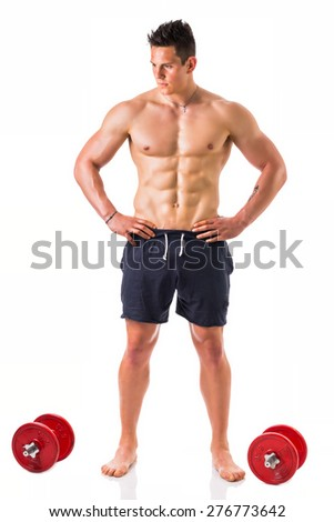 Handsome muscular shirtless young man holding dumbbells, isolated on white, full length shot - stock photo