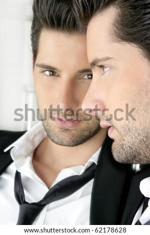 Handsome narcissistic suit proud young man looking himself in the mirror