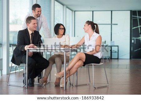 Handsome people working in company environment - stock photo