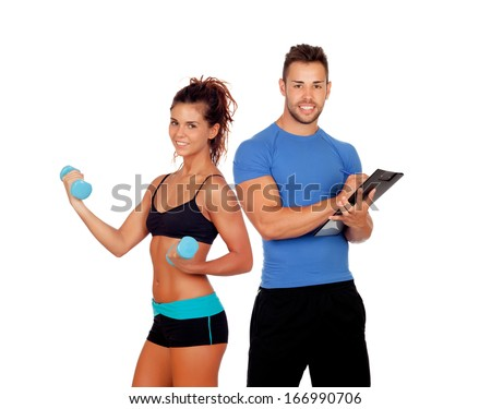Handsome personal trainer with beautiful girl with dumbbells isolated on white - stock photo