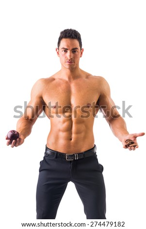 Handsome power athletic guy having apple and biscuits  isolated in white background - stock photo