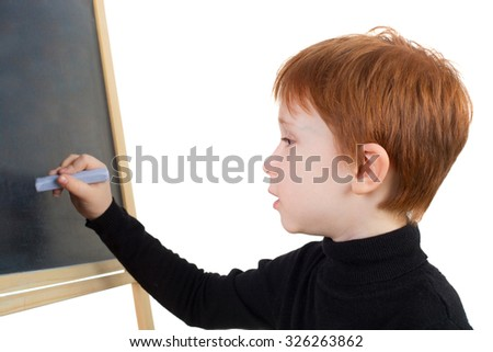 handsome red hair boy writing on the blackboard