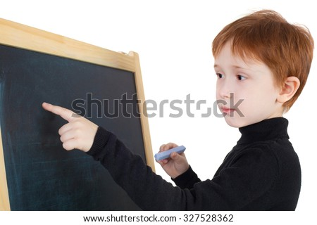 handsome red hair boy writing on the blackboard - stock photo