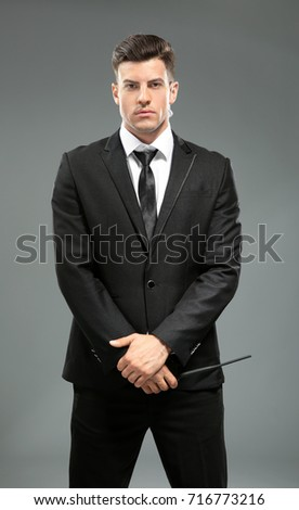 Handsome security guard on grey background