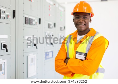 handsome senior african american technician in control room - stock photo