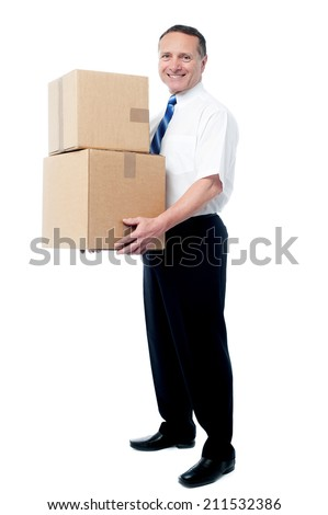 Handsome senior executive with stack of boxes - stock photo