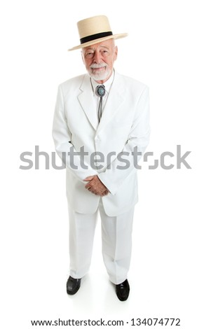 Handsome senior Southern gentleman in a white suit with a straw hat and a string tie.  Full body isolated. - stock photo
