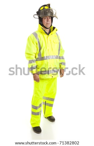 Handsome, serious fire fighter.  Full body isolated view. - stock photo