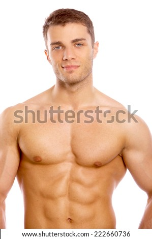 Handsome sexy naked young man with a muscular physique standing smiling at the camera  isolated on white