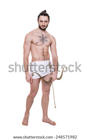 Handsome sexy  young man with bow and arrow. Antiquity, Valentine, Cupid. Studio portrait isolated over white background    - stock photo