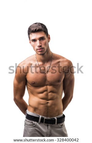 Handsome shirtless athletic young man in jeans, looking at camera in studio shot, isolated on white background - stock photo