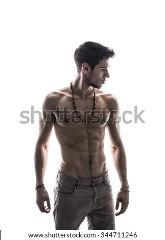 Handsome shirtless athletic young man, looking to a side in studio shot, isolated on white background - stock photo