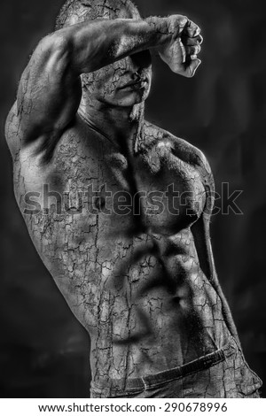 Handsome shirtless man torso with bark texture - stock photo