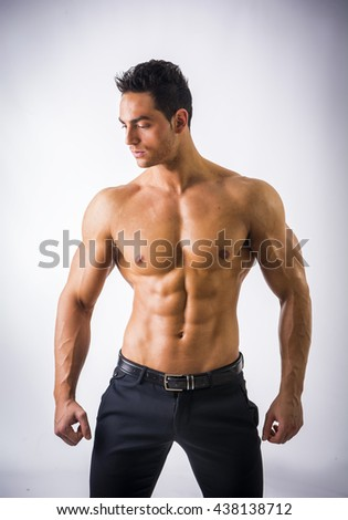 Handsome shirtless muscular man with elegant pants - stock photo