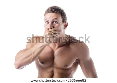 Handsome shirtless muscular young man covering his mouth with hand, not laughing or in silence - stock photo