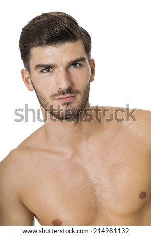 Handsome shirtless naked bearded young man standing looking intently at the camera with his hand to his chin in a sensual sexy pose, isolated on white - stock photo