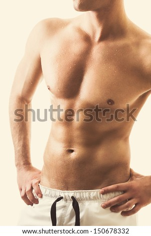 Handsome shirtless young man's torso - stock photo