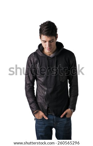 Handsome shyHandsome shy young man in black hoodie sweater standing, looking down, isolated on white young man in black hoodie sweater standing - stock photo