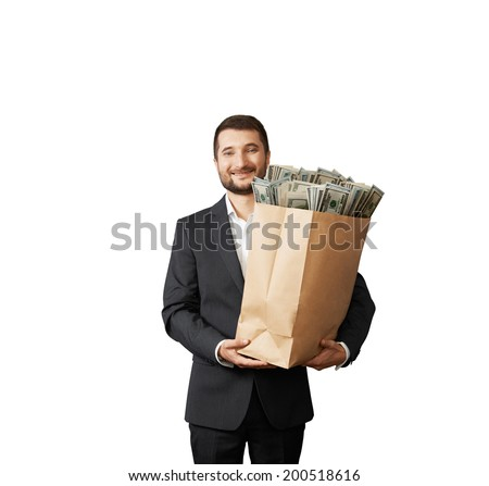 handsome smiley man holding paper bag with money. isolated on white background - stock photo