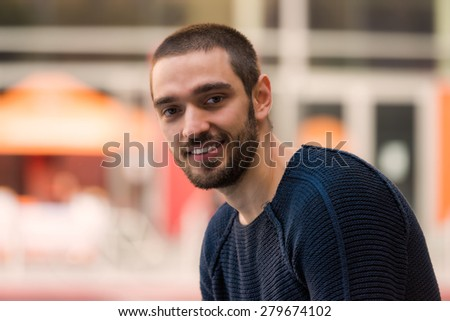 Handsome smiling and casual young man looking towards. High resolution photo.