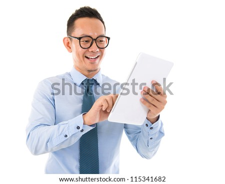 Handsome smiling Asian man with tablet computer. Isolated over white background