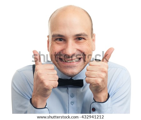 handsome smiling bald man showing his thumbs up. Isolated