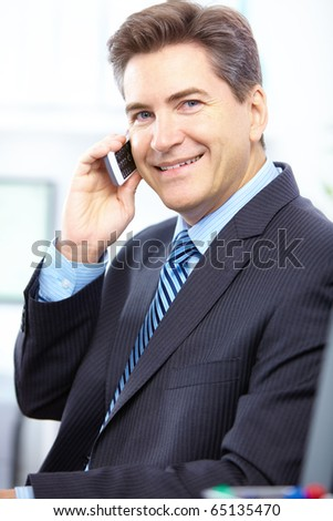 Handsome smiling business man calling