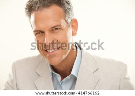 handsome smiling businessman gaze portrait isolated on white - stock photo