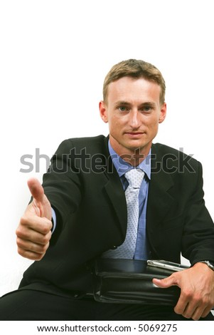 handsome smiling businessman looking at camera - stock photo