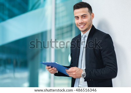 Handsome smiling businessman portrait outdoor