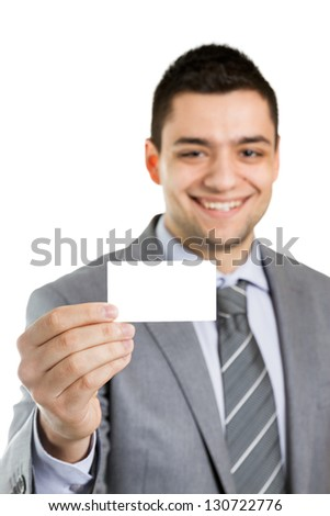 Handsome smiling businessman showing his business card. - stock photo