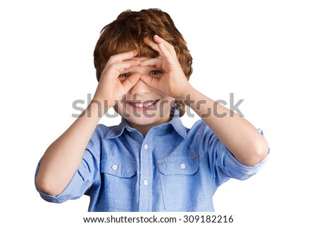 Handsome smiling caucasian boy with red hair makes aviator glasses with his hands. Isolated on white background - stock photo