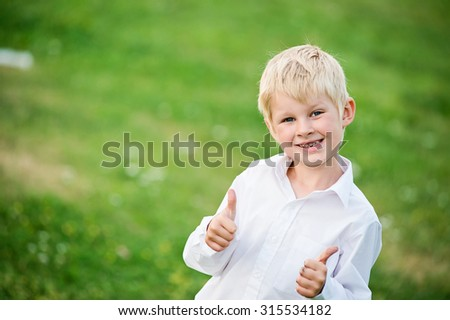 Handsome smiling child boy in business - stock photo