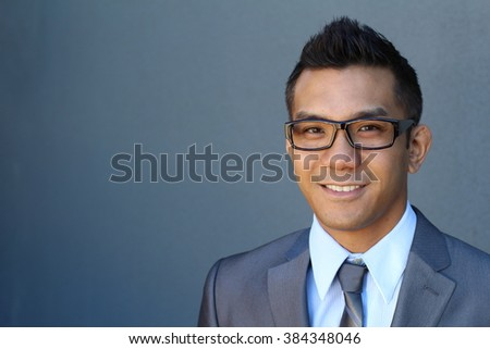 Handsome smiling confident ethnic businessman portrait with copy space on the right - stock photo