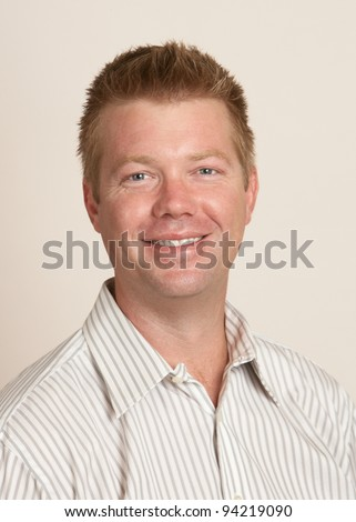 Handsome smiling happy young man headshot portrait - stock photo