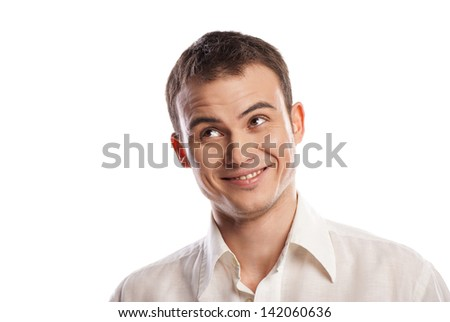 Handsome smiling young man looking up over white background - stock photo