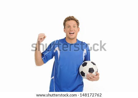 Handsome soccer player. Cheerful young soccer player gesturing with a soccer ball in his hand while isolated on white
