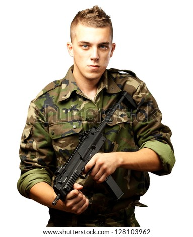 handsome soldier holding gun against a white background - stock photo