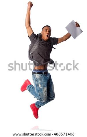 Handsome student jumping because of good grades, on white.