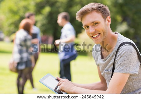 Handsome student studying outside on campus at the university - stock photo