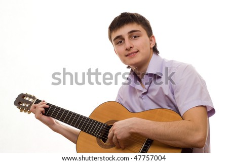 handsome student with a guitar on a white