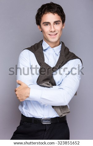 Handsome  style. Cheerful young man in smart casual wear looking at camera
