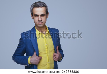 Handsome stylish man in shirt looking at the camera. Office worker. Business decisions. Beautiful light background - stock photo