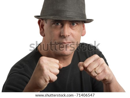 Handsome stylish tough man with fists up - stock photo