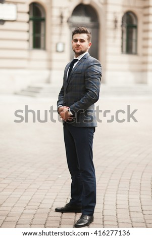 Handsome stylish young businessman posing portrait outdoor