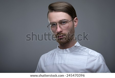 Handsome stylish young man. Brutal man with a beard and glasses